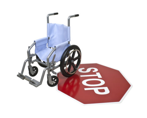 Wheelchair used for assistance in personal transportation on a red stop sign - path included